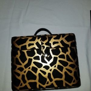 Black and gold makeup case